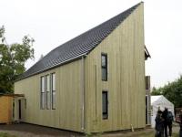 Une maison bois super-isolée avec de la laine de roche