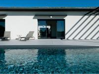 Un patio rythme la vie d'une maison passive