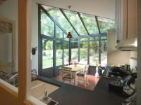 Petits espaces : Une véranda toute mignonne pour abriter une petite cuisine