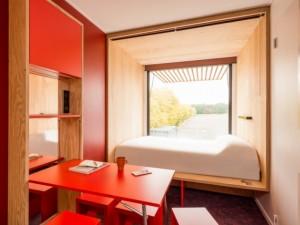 Des chambres d'hôtel mobiles dans des conteneurs