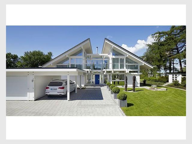 1 toit papillon se pose sur une maison for Piscine sur toit garage