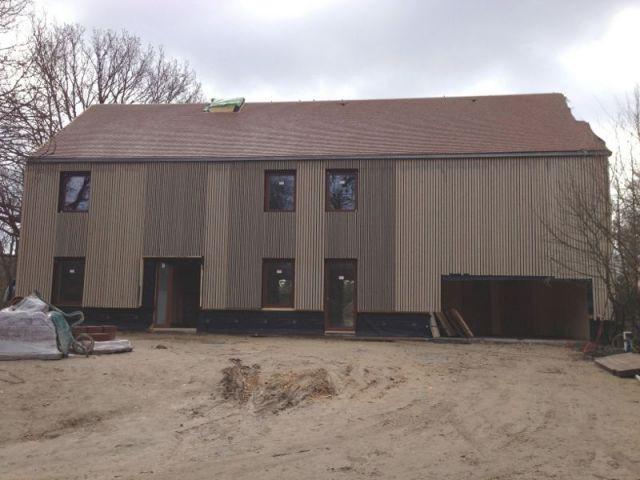 Une maison en bois massif mont e en 4 jours for Architecture vernaculaire