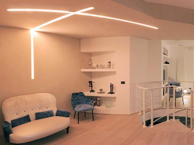 Un plafond dynamique - Une ambiance chaude grâce aux luminaires