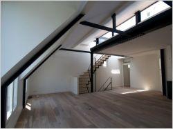 Quatre appartements transformés en duplex avec terrasse
