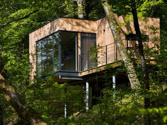 Des cabanes bois et design plong es dans la nature for Acheter une maison avec locataire