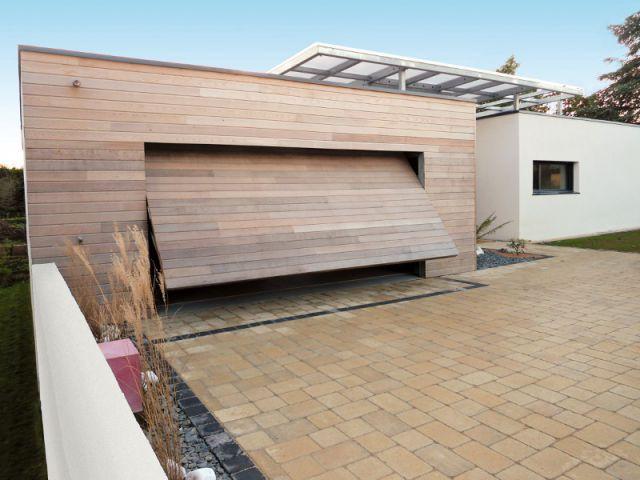 Des portes de garage fonctionnelles et design pour for Ajouter garage contre maison