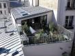 Un ancien atelier transformé en loft avec terrasse sur les toits