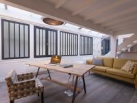 Avant/après : un atelier d'artiste transformé en loft lumineux