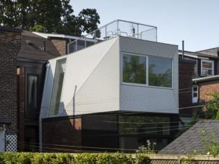 Une extension aux allures de container pour accueillir une nouvelle cuisine