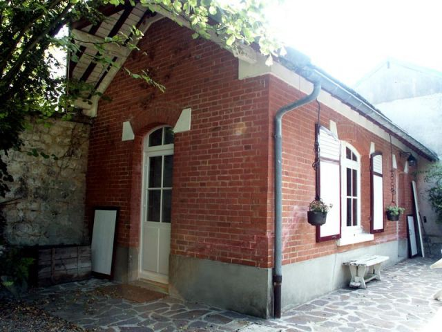 Maison de gardien au fond du jardin