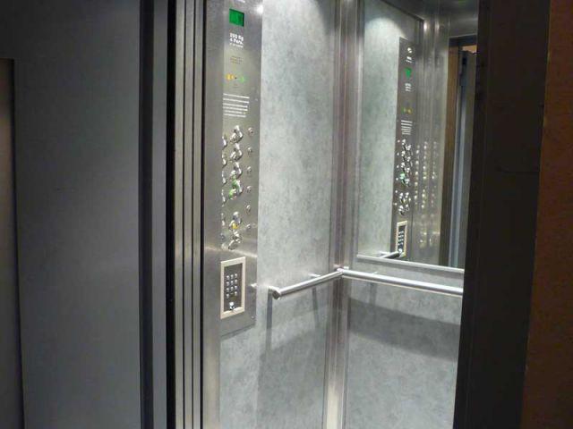 Un coût dépendant du contexte - ascenseur