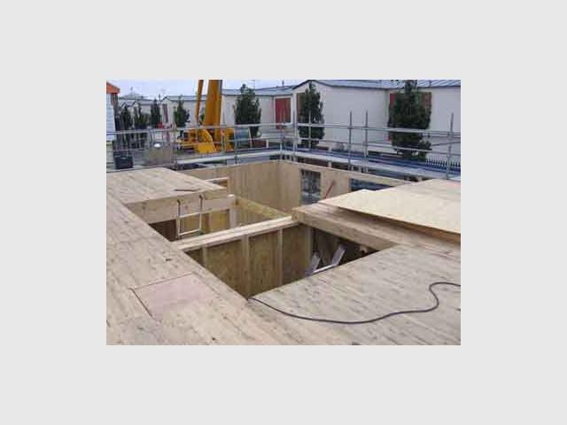 Pose du plancher - Maison écologique en bois