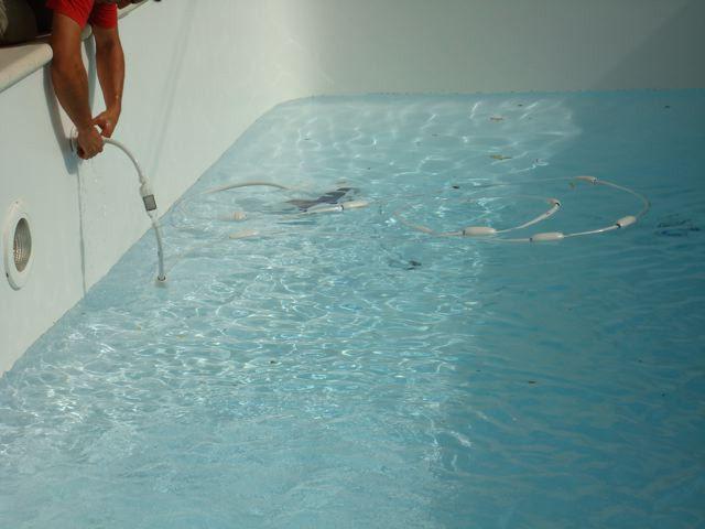 Mise en eau et découpe - pose du liner
