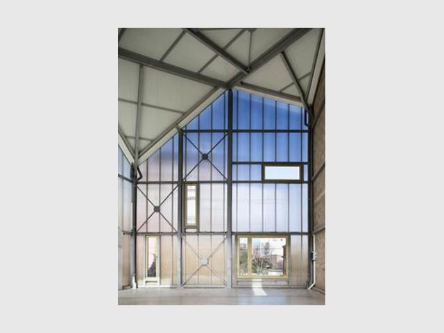 Des matériaux bruts - Maison trapèze