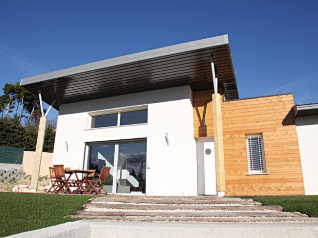 Une terrasse protégée du soleil - Maison Oxygène