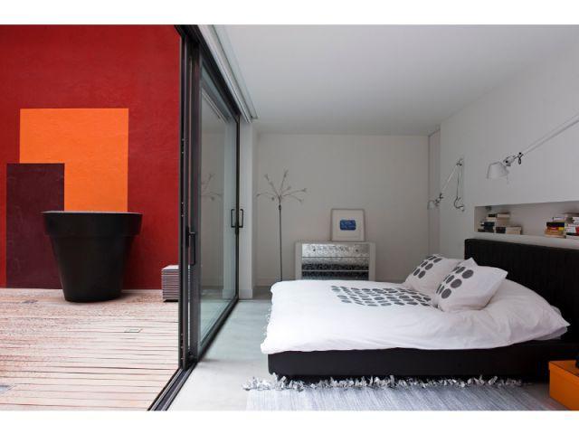 De part et d'autre de la véranda, des chambres - Loft Madrid