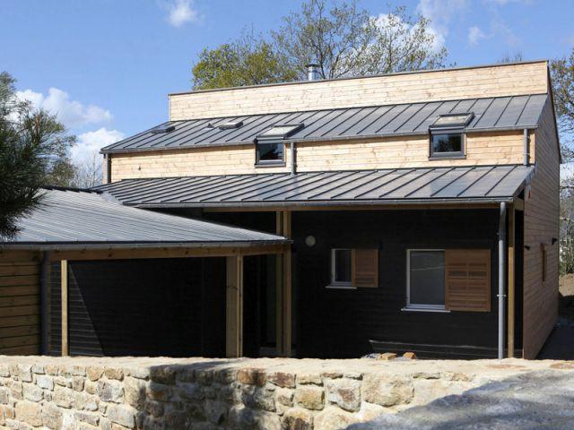 Bardage noir et perspectives - Maison organique bioclimatique