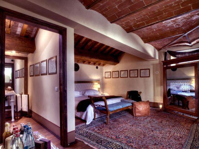Une chambre, ancien lieu de stockage de l'huile d'olive - Il Salviatino