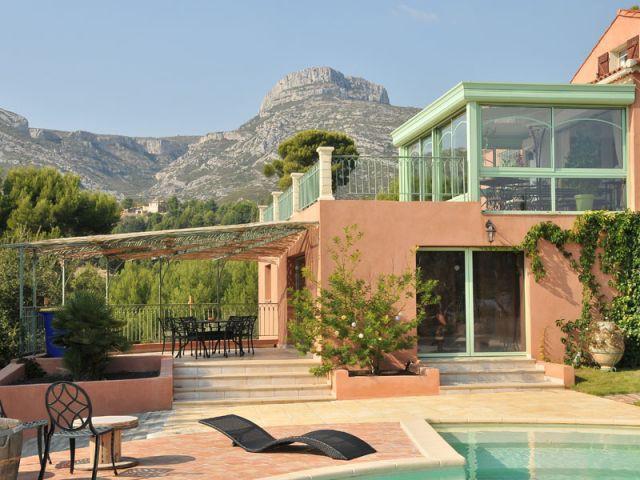 Deux terrasses pour plus de confort et de place - Véranda Primevère Reynaers verte