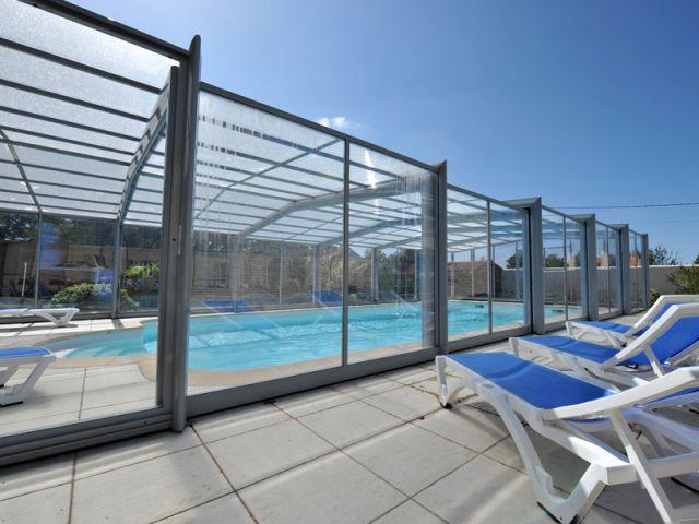 Un abri de piscine télescopique monté en quatre jours - Abri de piscine haut télescopique