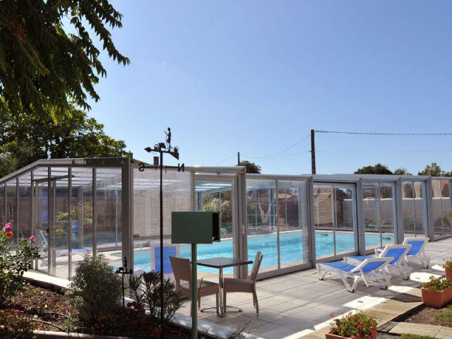 Un abri de piscine télecopique sur-mesure - Abri de piscine haut télescopique