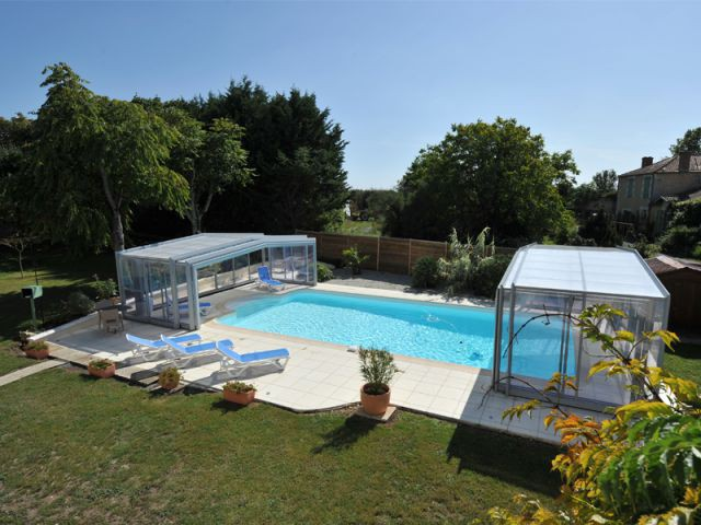 Une ouverture centrale pour l'abri de piscine - Abri de piscine haut télescopique