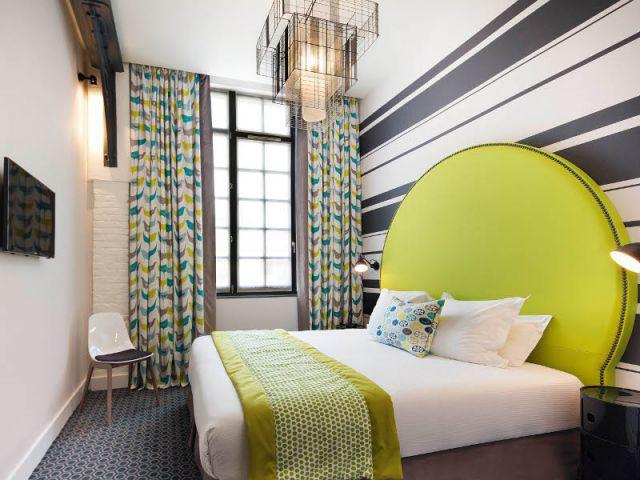 Dans les chambres, un décor inspiré de la dualité du quartier - Un ancien atelier de fabrication transformé en hôtel chic et moderne