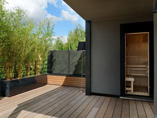 Un ancien local technique remplacé par un sauna - Un toit reconverti en terrasse