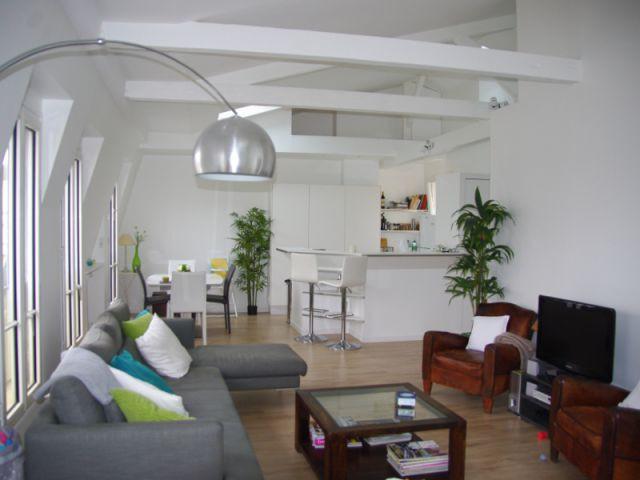 Un salon spacieux et lumineux - Rénovation d'un trois pièces dans le 15ème arrt de Paris