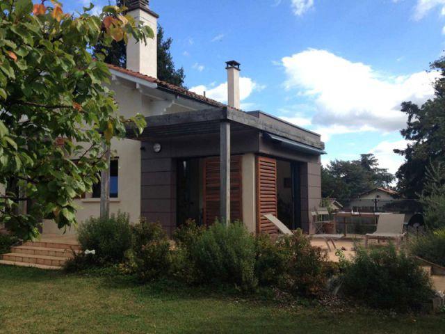 Des matériaux en harmonie avec le paysage - Deux extensions en bois pour une maison plus fonctionnelle