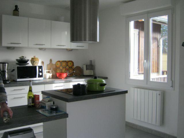 Un chauffage qui offre une meilleur inertie thermique - Reconstruction totale d'une maison incendiée