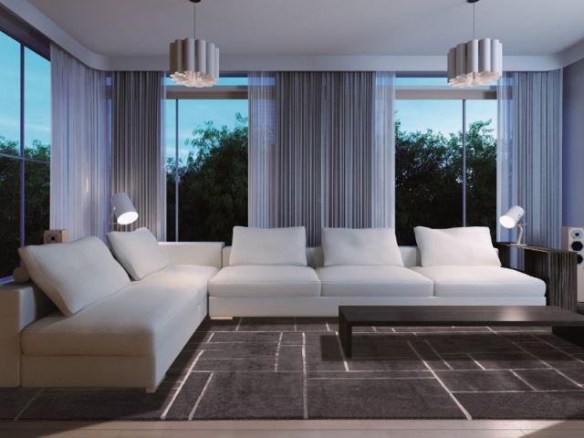 Des spots de lumières pour encadrer le coin salon et mettre en valeur le mobilier - Salon la nuit