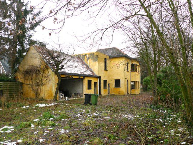 Une rénovation dans le respect de l'existant - Maison noire en Belgique