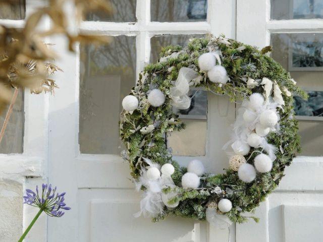 L'esprit de Noël sur la porte d'entrée - L'esprit de Noël souffle dans toute la maison