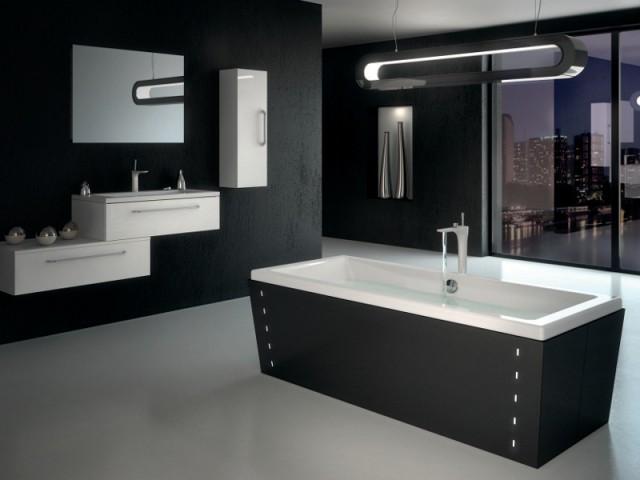 Une baignoire rétroéclairée au coeur d'une salle de bains futuriste - Une baignoire au milieu de la salle de bains