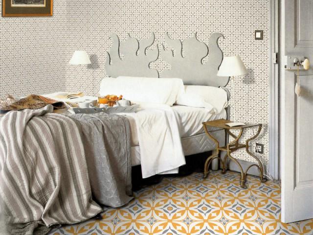 Des carreaux de ciment au sol et aux murs de la chambre - Les carreaux de ciment dans la déco