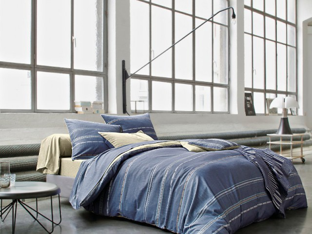 Un mobilier discret pour ne pas voler la vedette à la vue - Une chambre ouverte sur l'extérieur