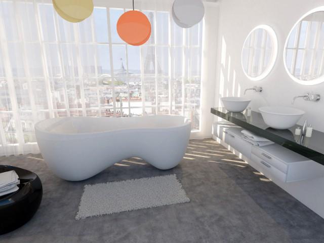 Une salle de bains avec une baignoire face à la baie vitrée - Une salle de bains ouverte sur l'extérieur
