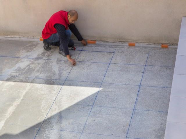 Réalisation d'un calepinage précis - Rénovation terrasse sur plots