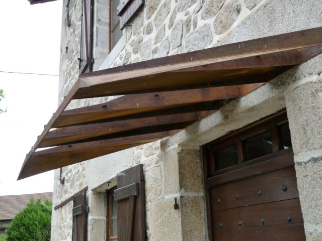 Une petite marquise parfaitement intégrée - La Canopée - Abri de garage