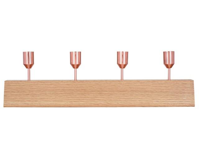 Sur la console du salon, un bougeoir en bois et cuivre rosé - Tendance cuivre rosé