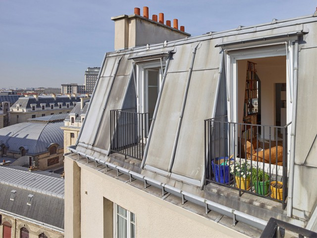 Fiche technique :  - Un appartement structuré et dynamisé par des livres