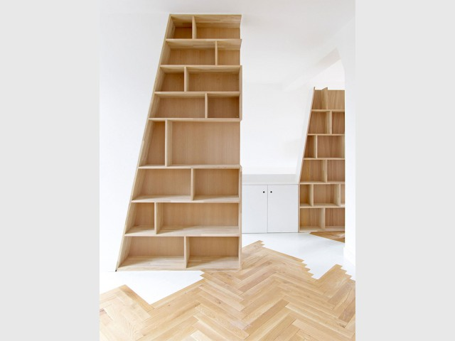 Priorité aux pièces à vivre  - Un appartement structuré et dynamisé par des livres