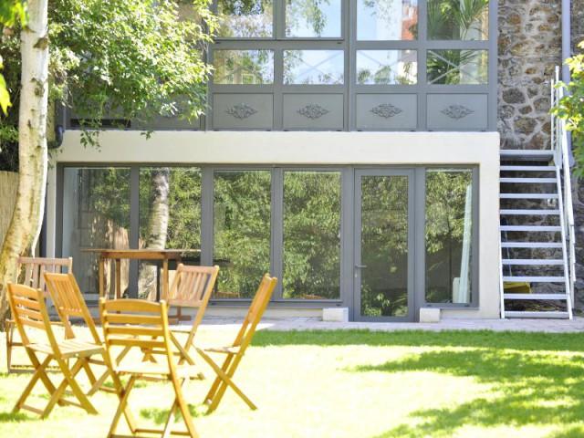 Une véranda à l'esthétique soignée - Extension véranda d'une maison meulière