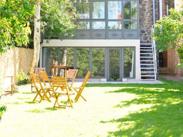 Une véranda qui allie le traditionnel au moderne - Extension véranda d'une maison meulière