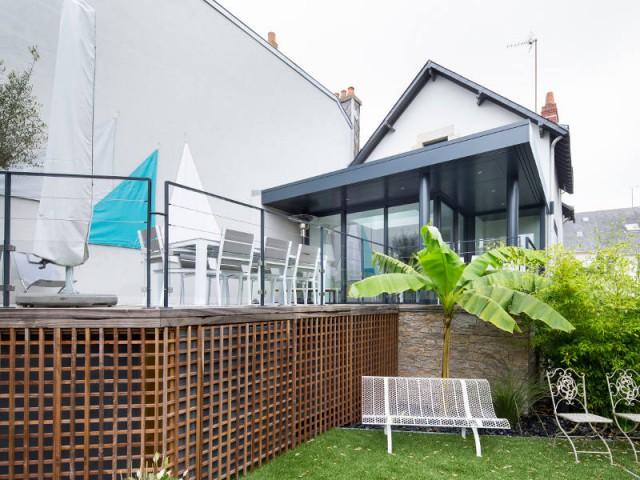 Une véranda et une terrasse dans la continuité - Véranda Extens'K