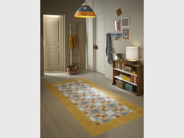 Un tapis coloré pour délimiter une entrée - Délimiter un espace grâce au sol