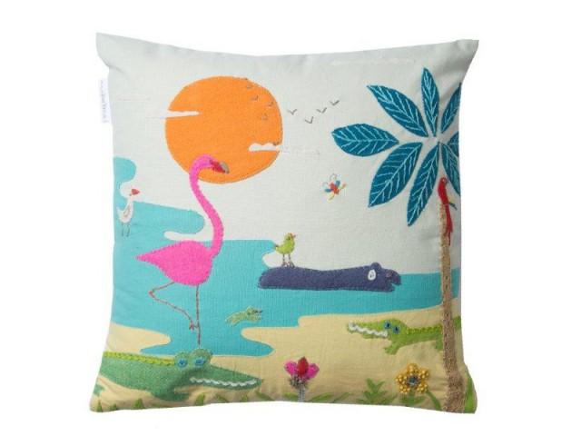 Un coussin paysage pour un canapé art naïf - La tendance Floride envahit les intérieurs