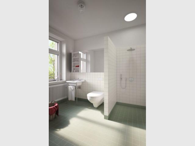 Après : une salle de bains optimisée et baignée de lumière - Maison Renov Active à Bruxelles par Velux