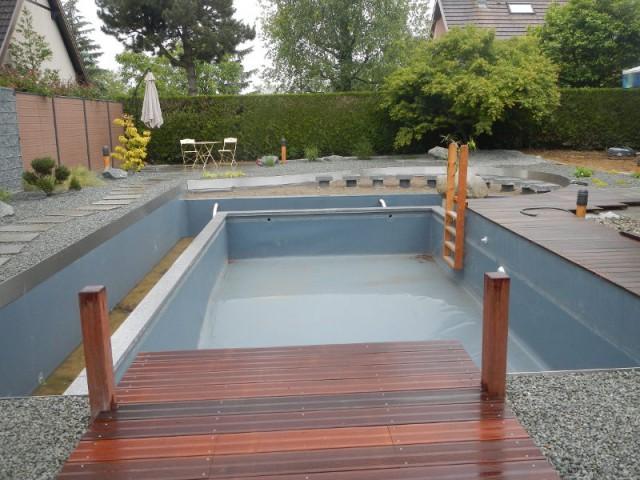 Une piscine naturelle difficile à installer - Une piscine naturelle en Alsace